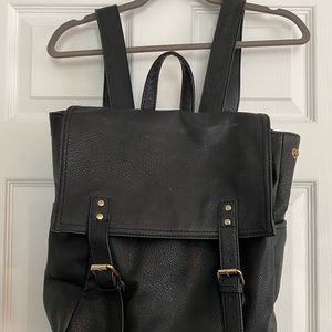 Black vegan leather backpack w/ snap closures